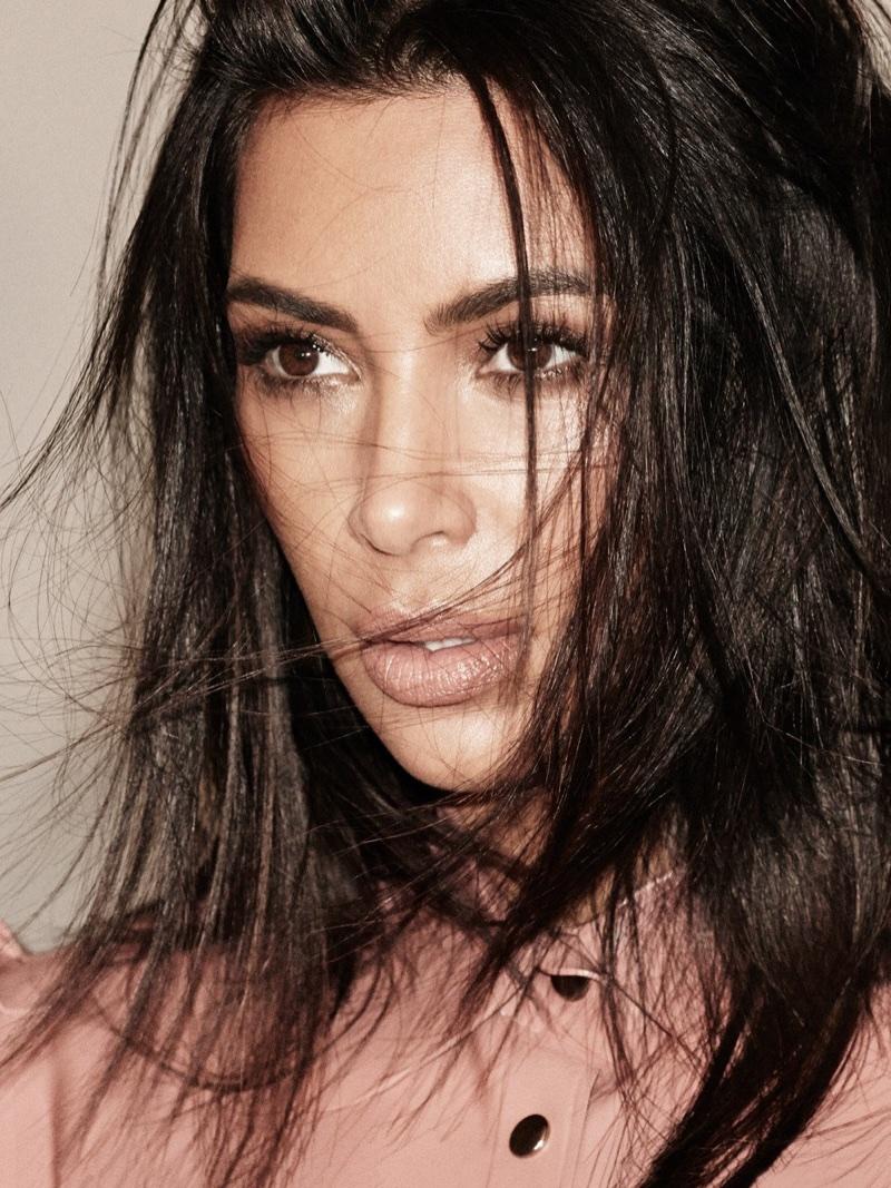 Wearing a messy hairstyle, Kim Kardashian poses in Ktsuko Kudo latex top