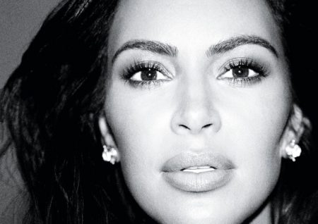 Kim Kardashian models Elizabeth Lock earrings