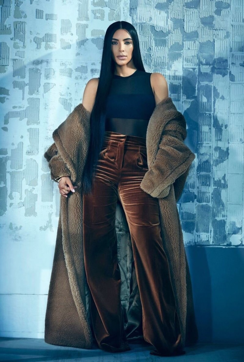 Covering up, Kim Kardashian poses in Max Mara coat and trousers