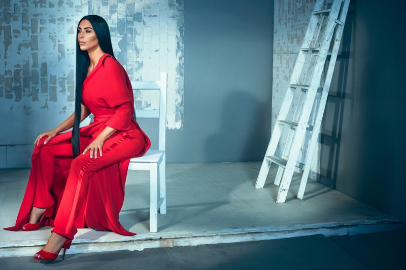 Dressed in red, Kim Kardashian wears Givenchy dress, trousers and heels