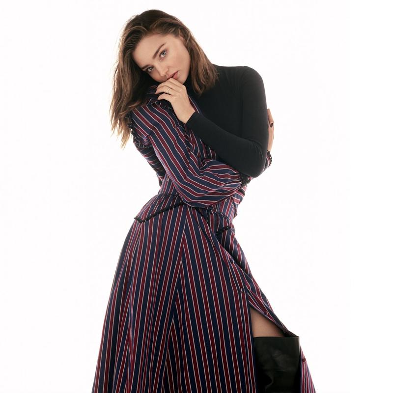 Miranda Kerr poses in Erdem dress, Wolford bodysuit and Petar Petrov boots