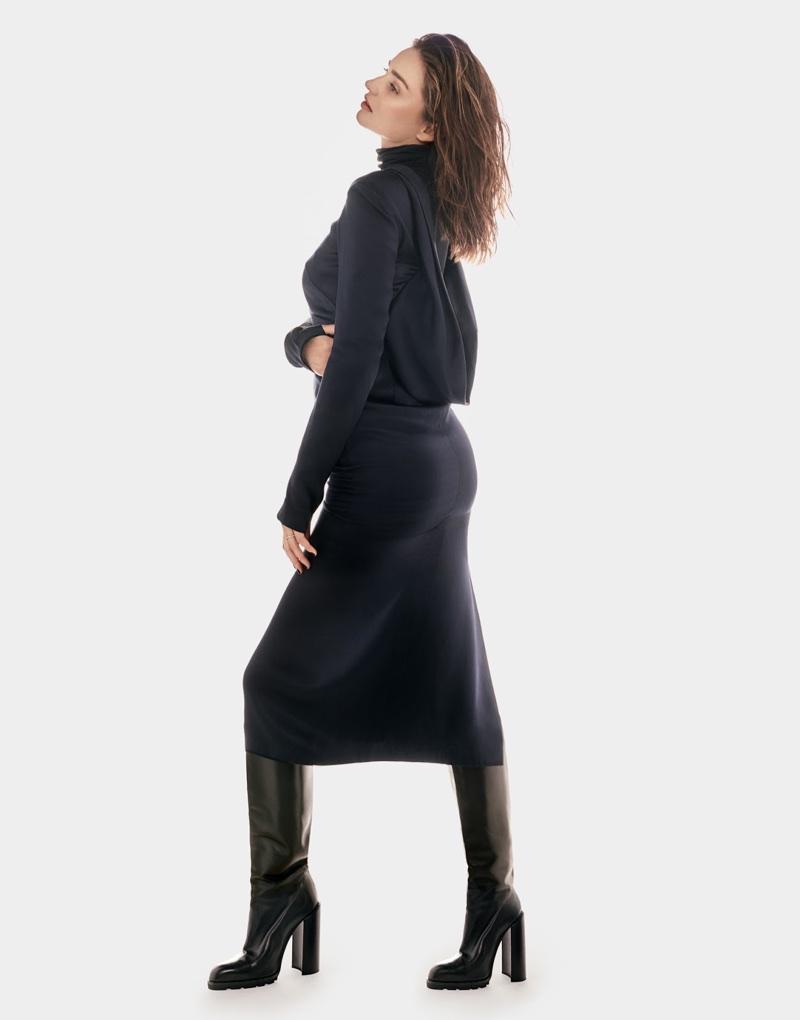 Miranda Kerr poses in Gabriela Hearst dress and Jil Sander boots