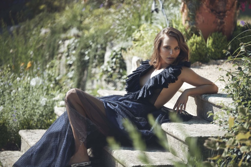 Actress Natalie Portman poses in blue maxi dress