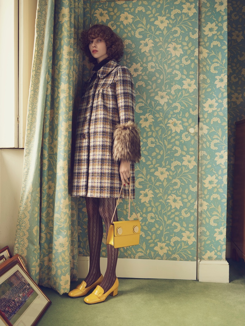 Lorena Maraschi wears a plaid coat in Orla Kiely's fall-winter 2017 campaign