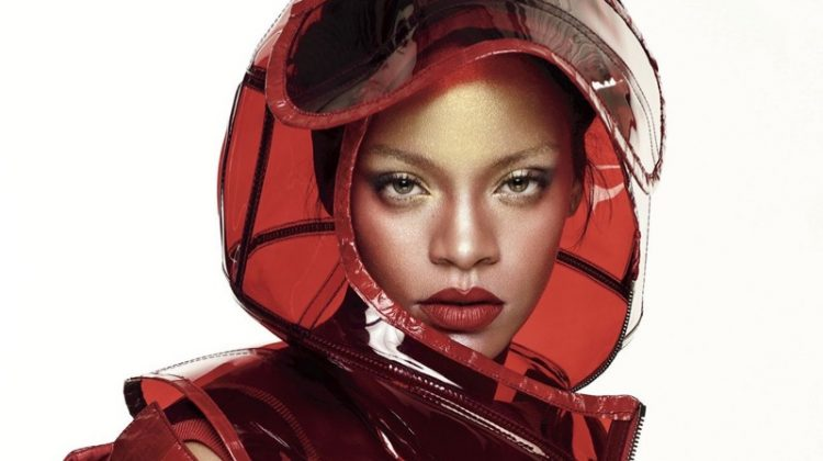 Wearing red lipstick, Rihanna poses in Dolce & Gabbana helmet and PVC coat