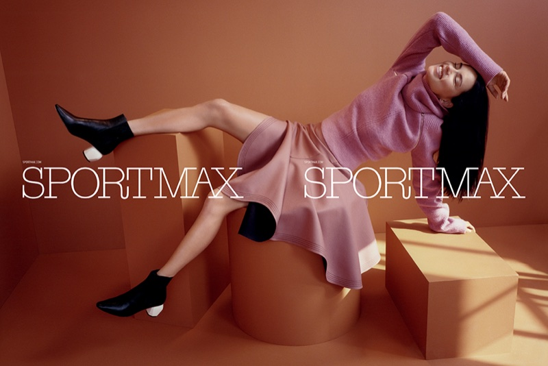 Adriana Lima wears pink sweater and skirt in Sportmax's fall-winter 2017 campaign