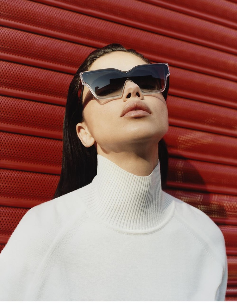 Wearing a turtleneck, Adriana Lima shows off cat eye sunglasses from Sportmax