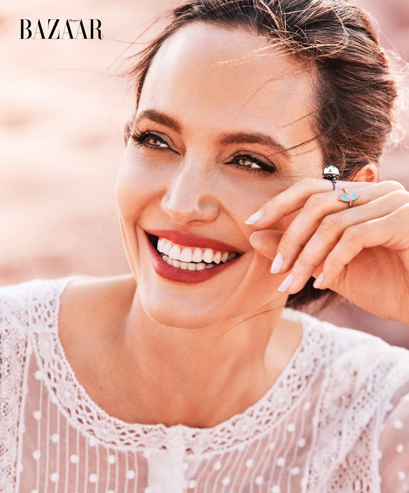 Getting her closeup, Angelina Jolie poses in Dior dress and rings