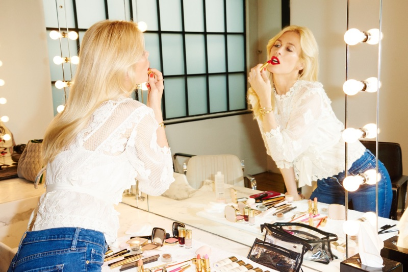 Supermodel Claudia Schiffer tries on lipstick from her debut makeup line