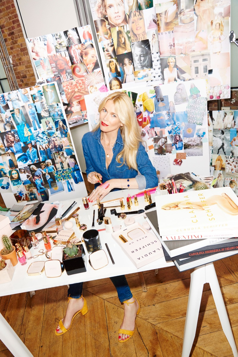 Claudia Schiffer poses with her makeup collection
