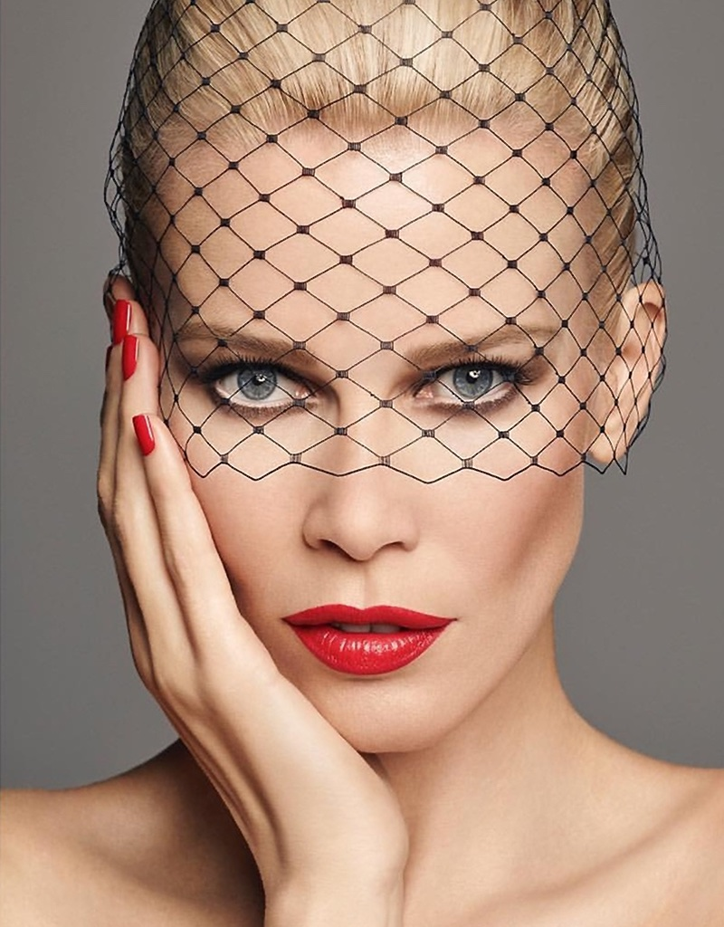 Claudia Schiffer stuns in red lipstick with matching manicure