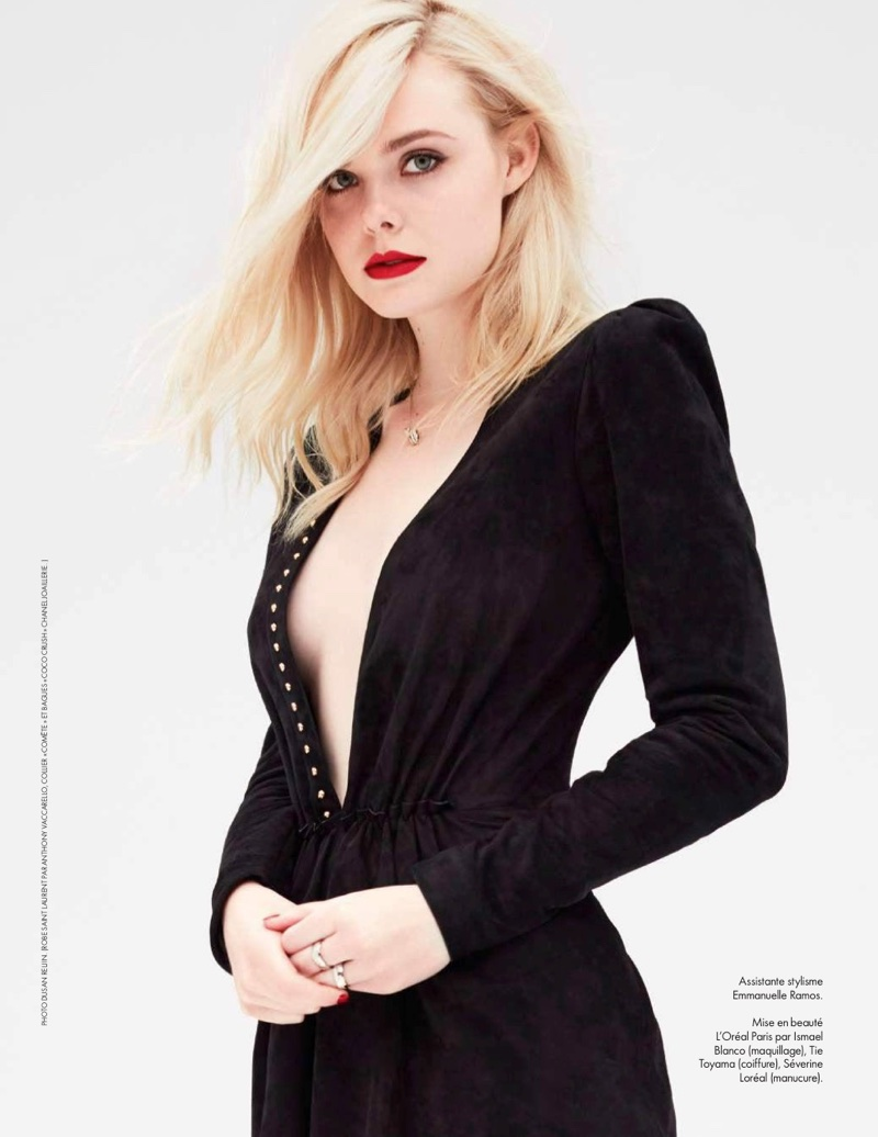 Clad in black, Elle Fanning poses in Saint Laurent dress with Chanel jewelry