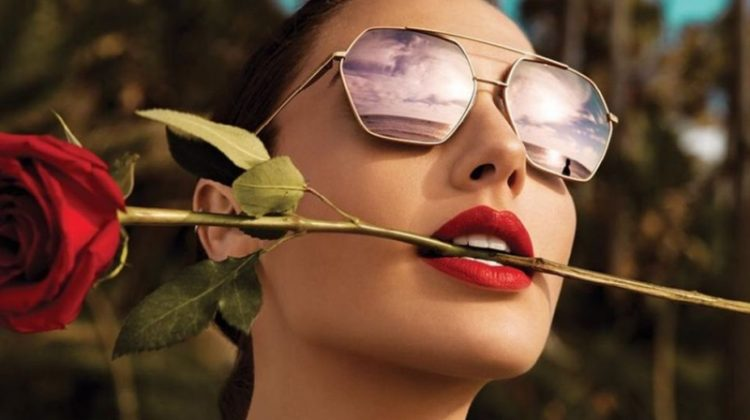 Actress Gal Gadot poses with a red rose for Erroca eyewear campaign