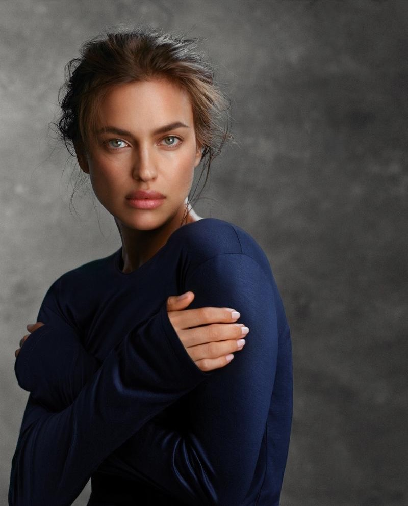 Model Irina Shayk covers up in blue Intimissimi top