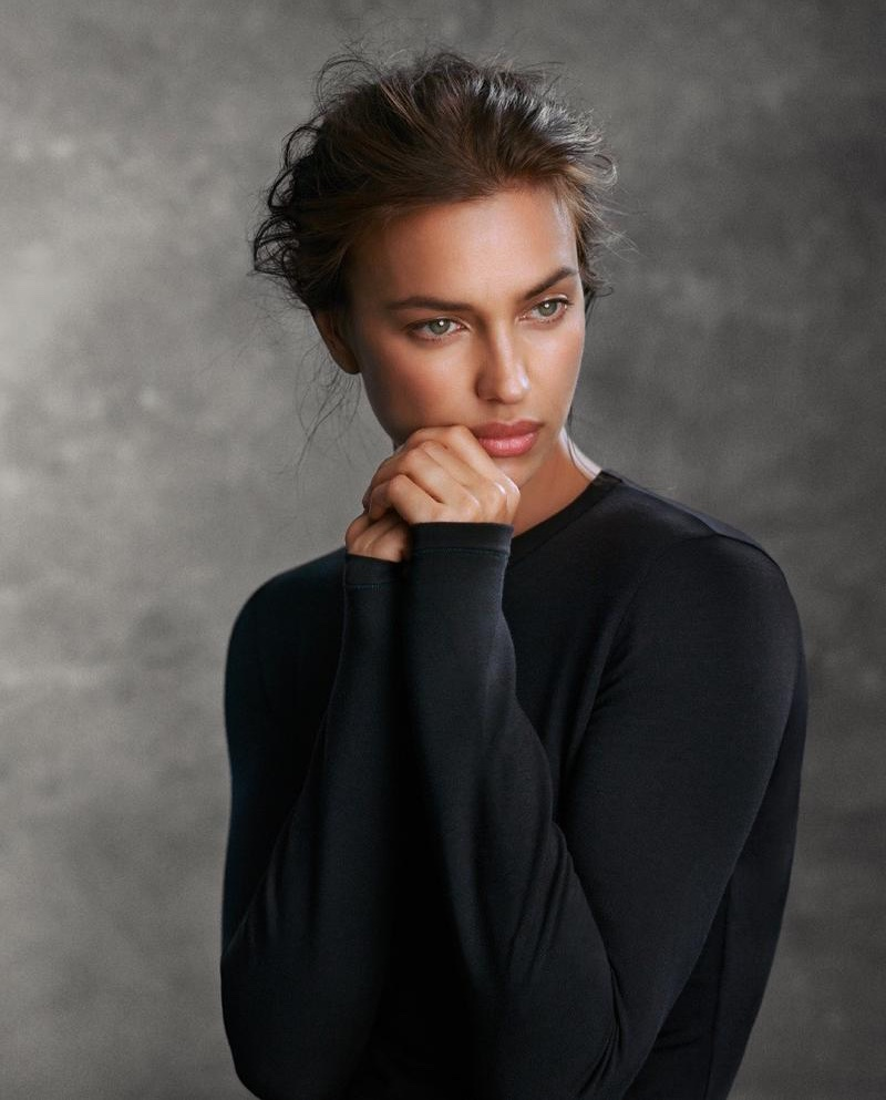 Model Irina Shayk covers up in black long-sleeve top from Intimissimi