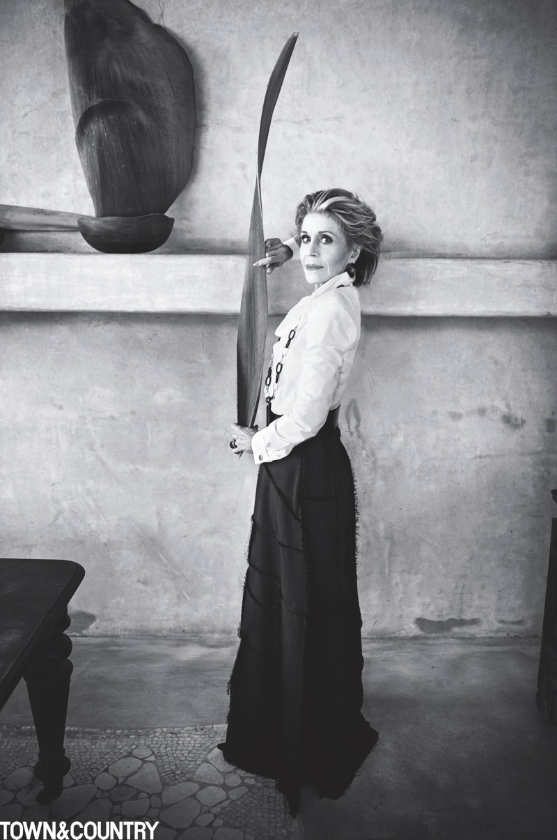 Photographed in black and white, Jane Fonda wears Ralph Lauren Collection shirt, The Row skirt and Vhernier necklace