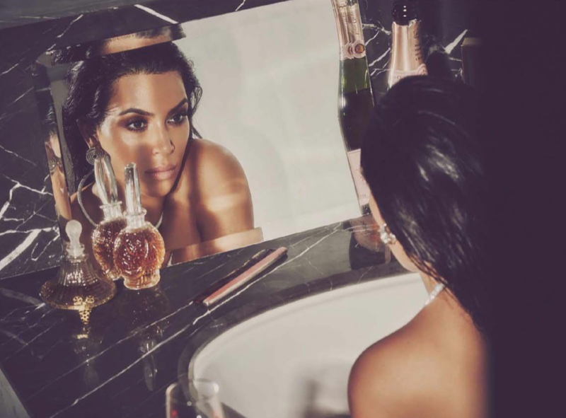Looking in the mirror, Kim Kardashian wears Cartier jewelry