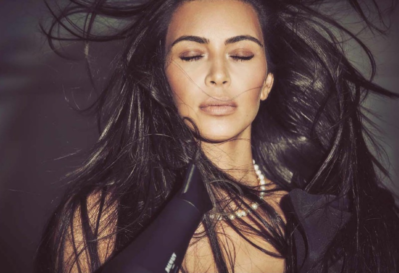 Posing with a blowdryer, Kim Kardashian wears Johanna Ortiz dress and Mordekai choker necklace