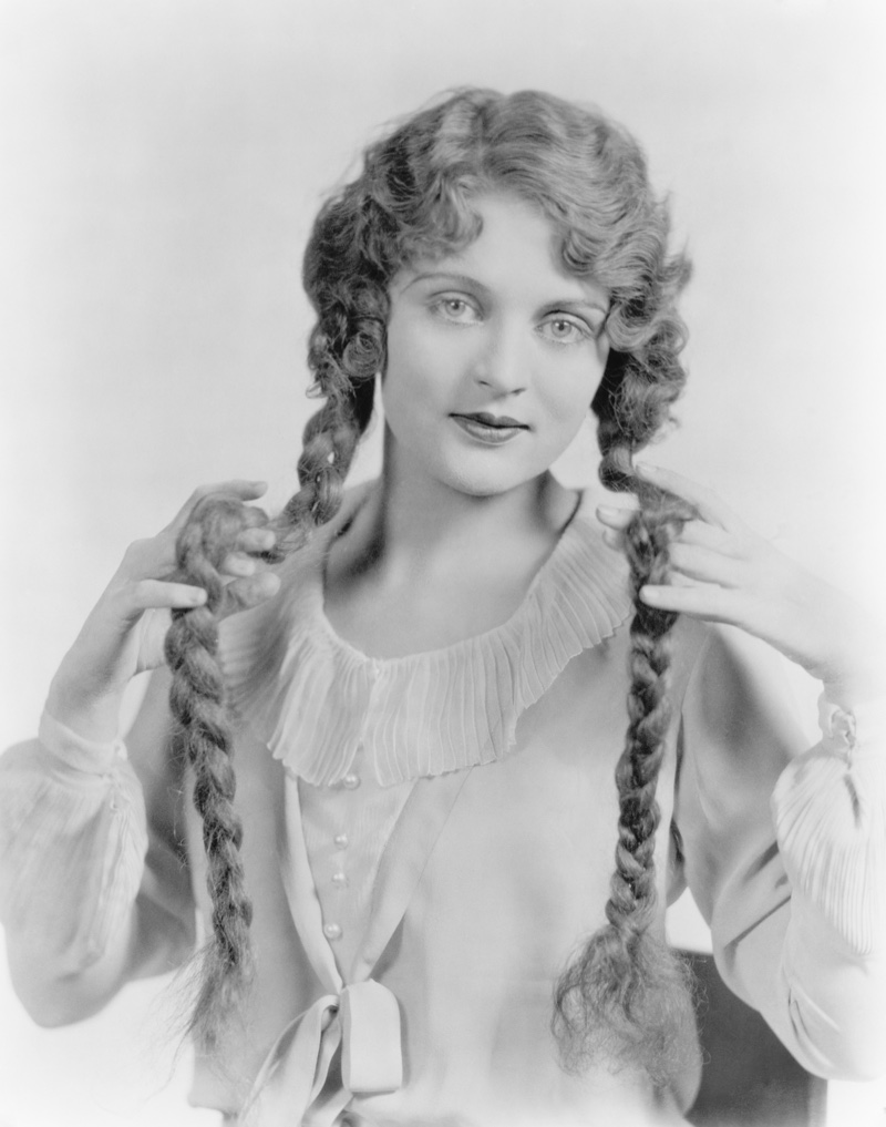 Long hair was also popular in the 1920s. Here's a woman with waves and braided pigtails. Photo: Shutterstock.com