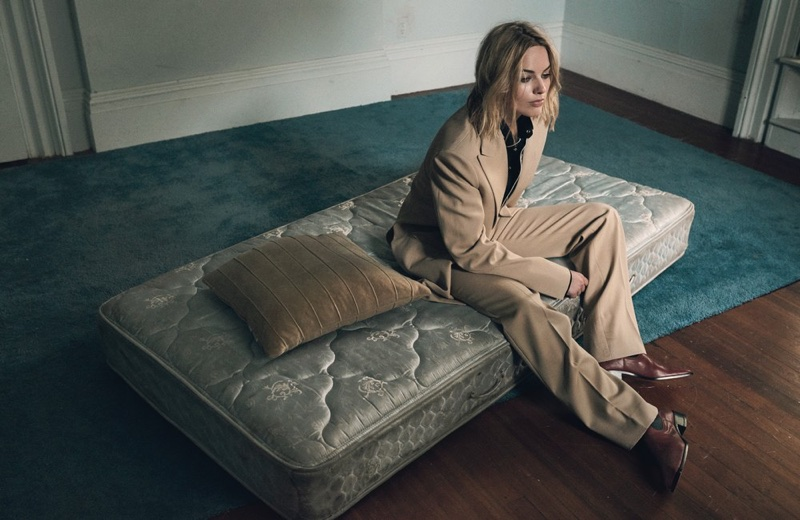 Posing on a mattress, Margot Robbie wears Celine jacket, pants and boots with Linder shirt