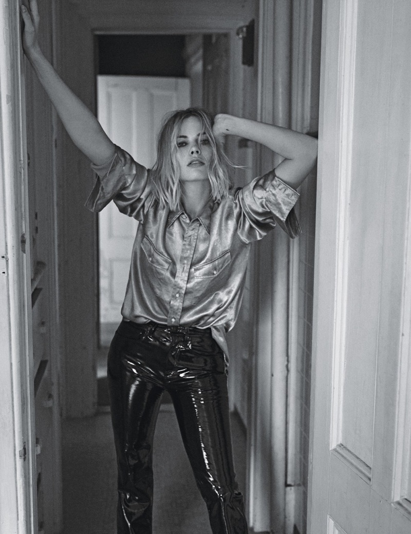 Striking a pose, Margot Robbie wears Gucci shirt and Rag & Bone trousers