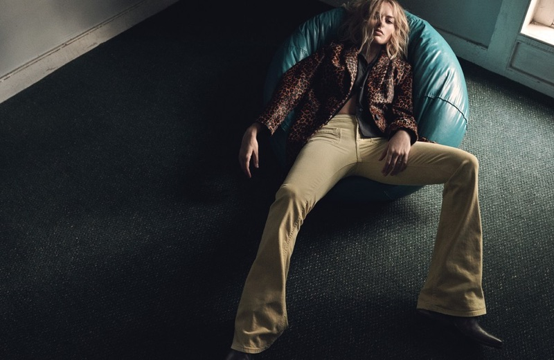 Actress Margot Robbie wears Dondup coat and pants, Acne Studios shirt and Golden Goose Deluxe Brand boots