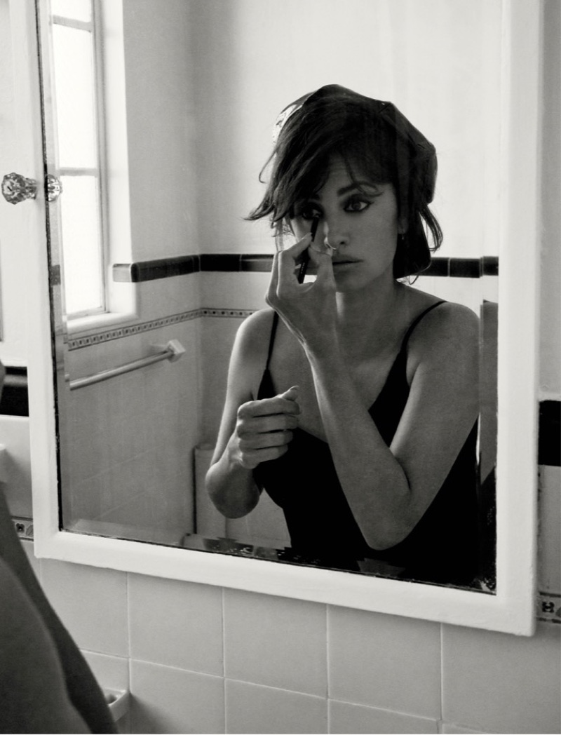 Looking in the mirror, Penelope Cruz wears Miu Miu hat and dress