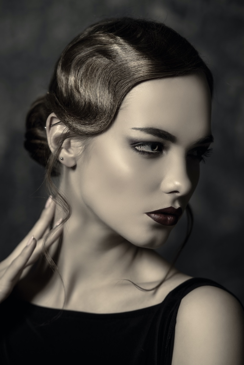 This sleek updo hairstyle features a wavy front for a 1920s look made modern.