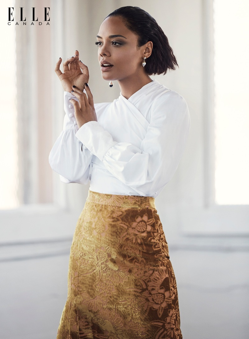 Tessa Thompson poses in Erdem shirt and skirt with Sophie Buhai earrings