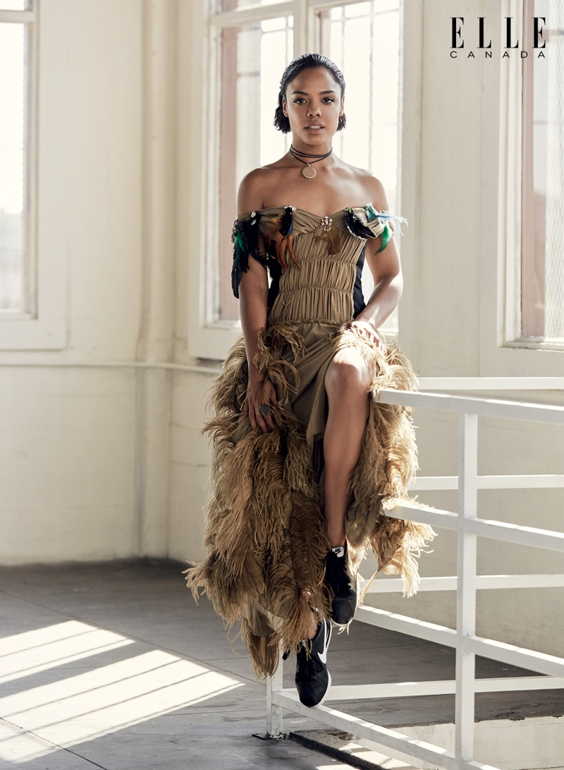 Tessa Thompson wears Sonia Rykiel dress, Sophie Bahai jewelry and Nike sneakers