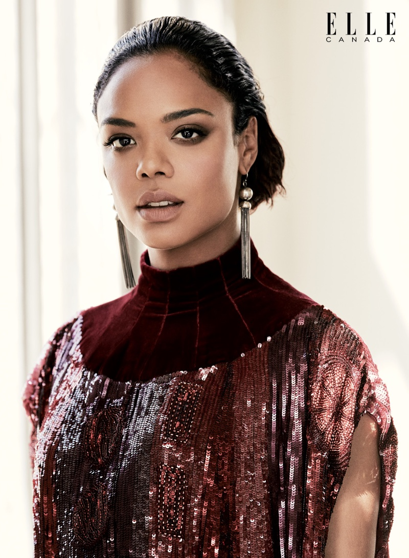 Tessa Thompson poses in Valentino sequined velvet dress and Sophie Buhai earrings