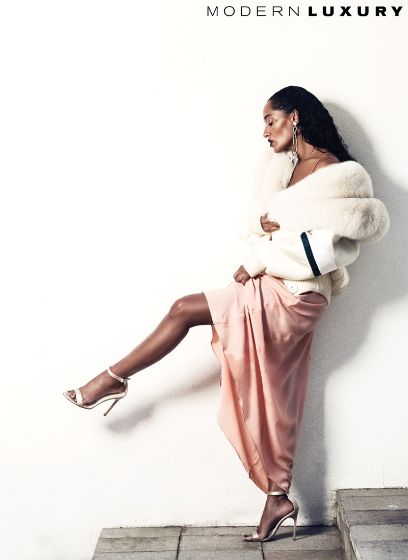 Looking glam, Tracee Ellis Ross wears Miu Miu coat, dress and earrings with Manolo Blahnik sandals