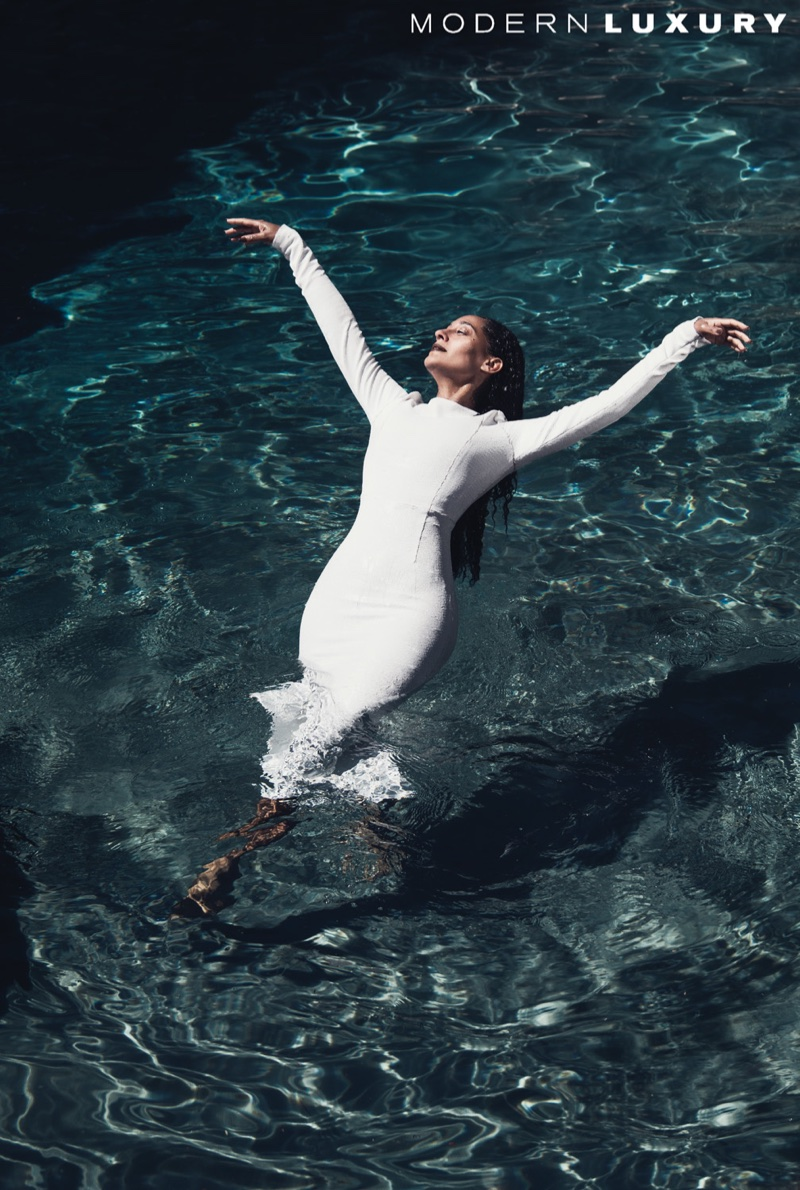Taking a dip, Tracee Ellis Ross poses in white dress