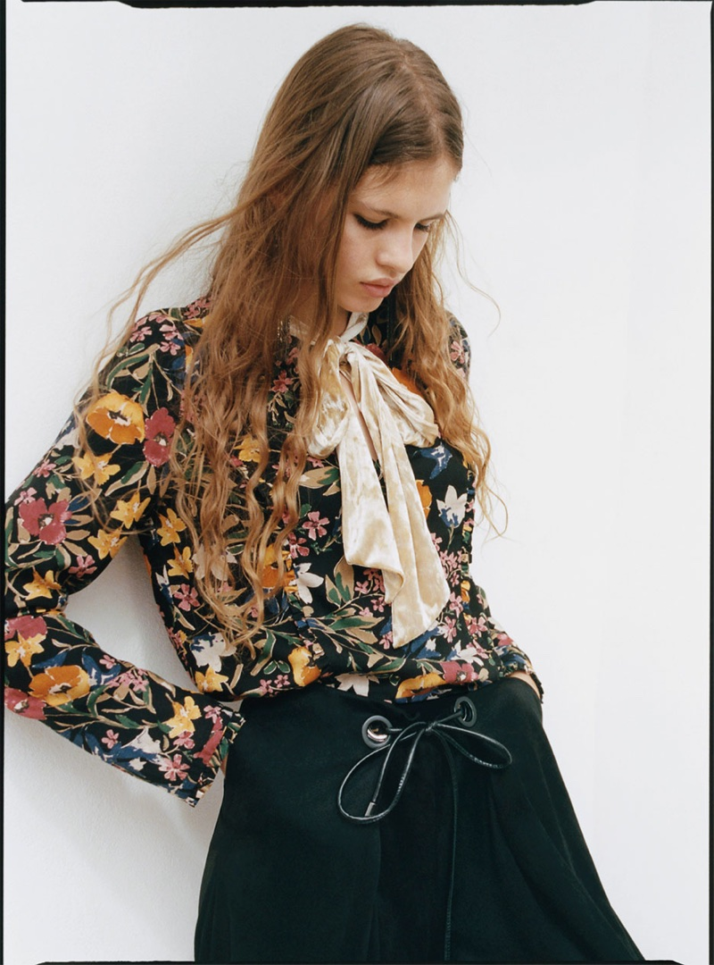 Model wears Zara printed top with bow and faux suede culottes