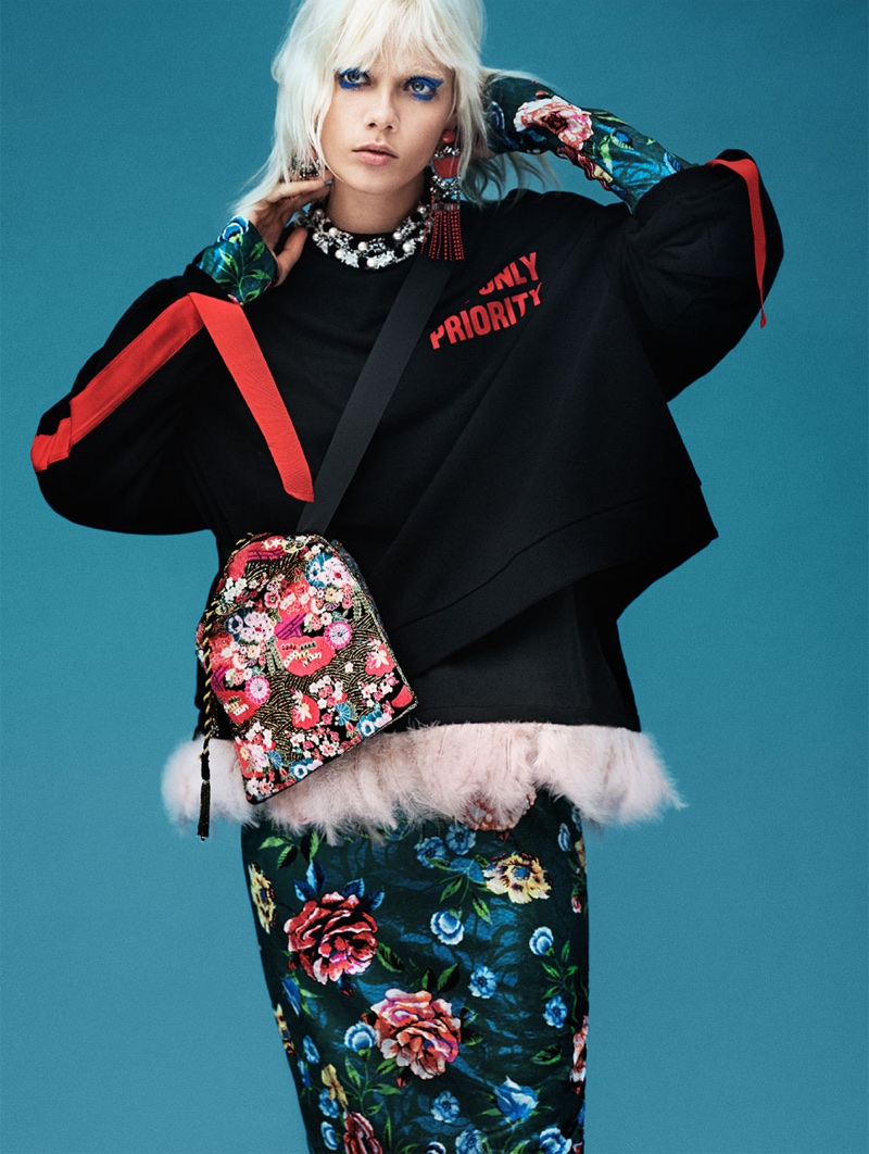 Marjan Zonkman poses in Zara Sweatshirt with Side Straps, Feathered T-Shirt, Floral Print Dress and Bucket Bag