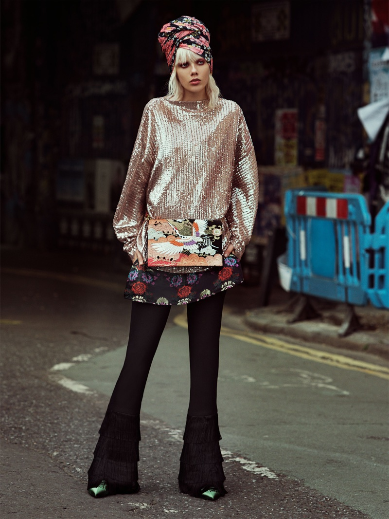 Marjan Zonkman poses in Zara Sequined Pleated Dress, Trousers with Fringed Hems, Strappy Mini Dress and Green Ankle Boots