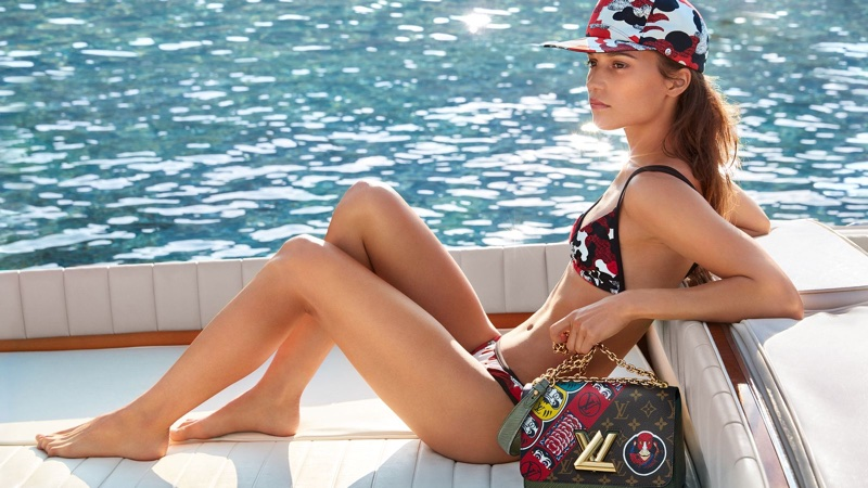 Clad in a bikini, Alicia Vikander poses in Louis Vuitton cruise 2018 campaign