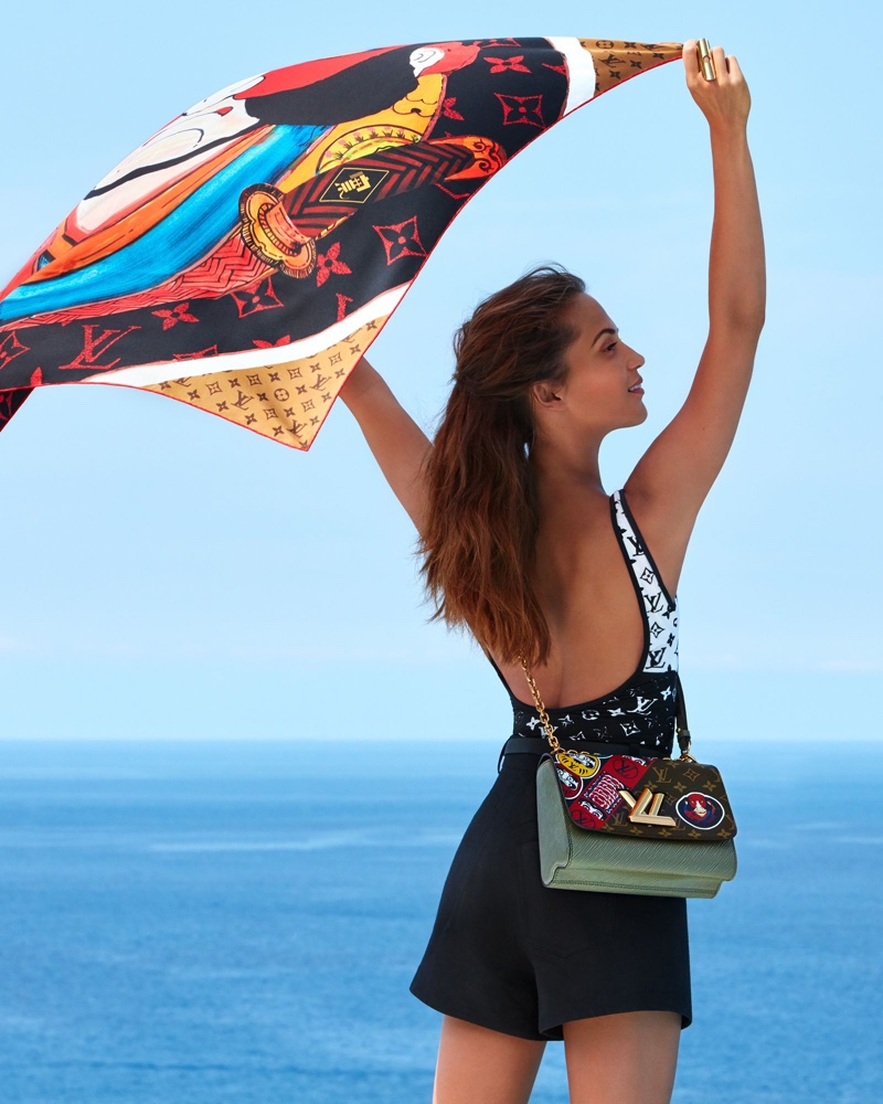 Alicia Vikander poses with Kabuki stickers shawl and Twist MM bag for Louis Vuitton's cruise 2018 campaign