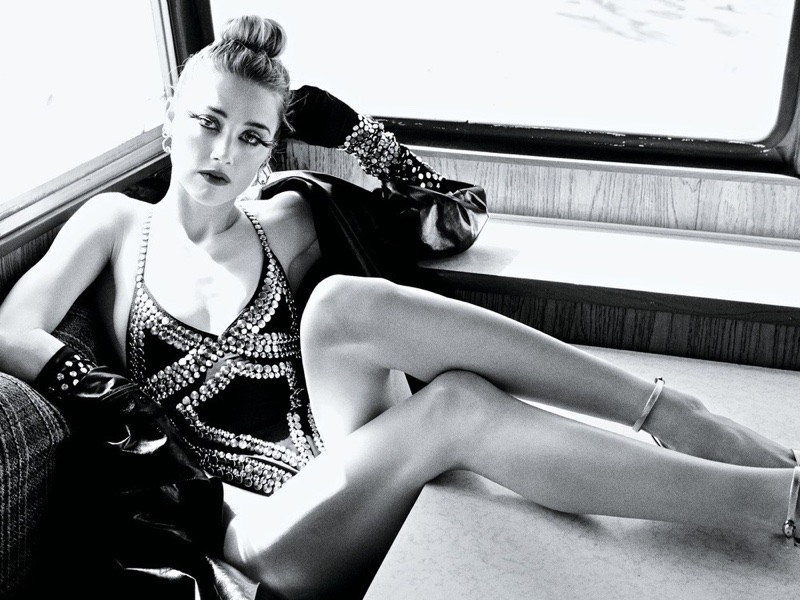 Actress Amber Heard wears Ralph Lauren Collection leather jacket, Norma Kamali bodysuit and gloves with Alexis Bittar earrings