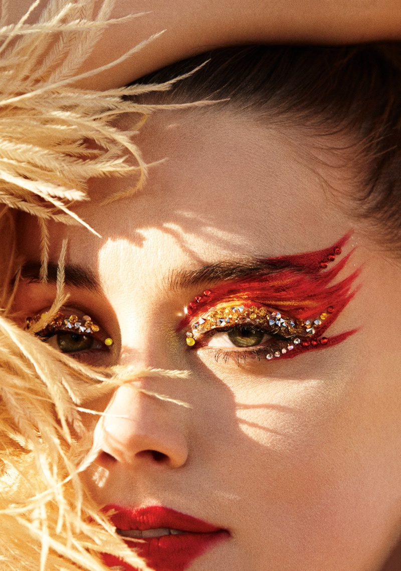 Amber Heard shows off glittering eye makeup with Norma Kamali feather jacket