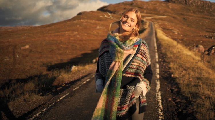 Model Constance Jablonski layers up in knit scarf and striped sweater for Anthropologie's November 2017 catalog