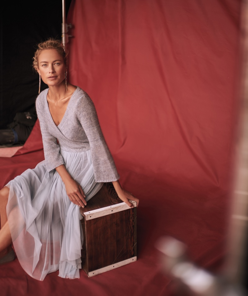 Carolyn Murphy poses in wrap top and pleated skirt for Anthropologie's November 2017 catalog