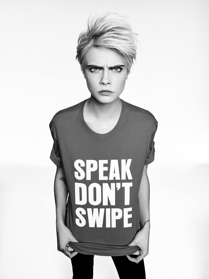 Model Cara Delevingne poses in Armani Exchange Speak Don't Swipe tee
