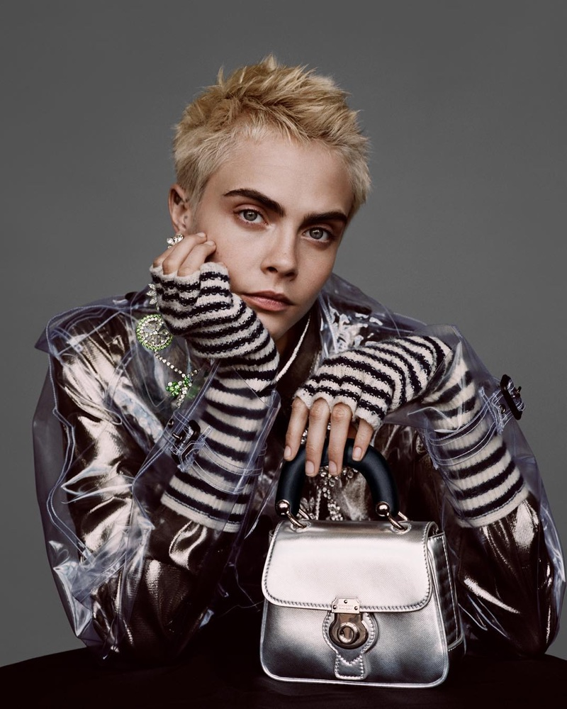 Model Cara Delevingne wears PVC coat and The DK88 bag in Burberry's Holiday 2017 campaign