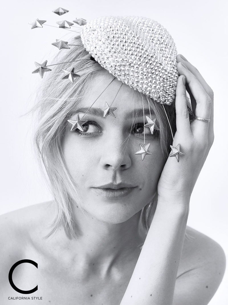 Actress Carey Mulligan poses in embellished Gucci headpiece