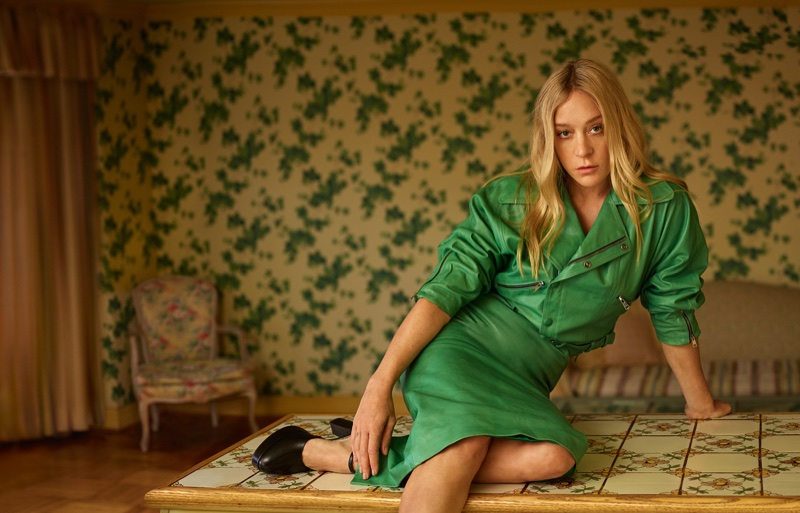 Going green, Chloe Sevigny wears Gucci leather jacket and mid-length skirt