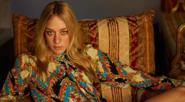 Embracing retro prints, Chloe Sevigny poses in Gucci blouse and skirt