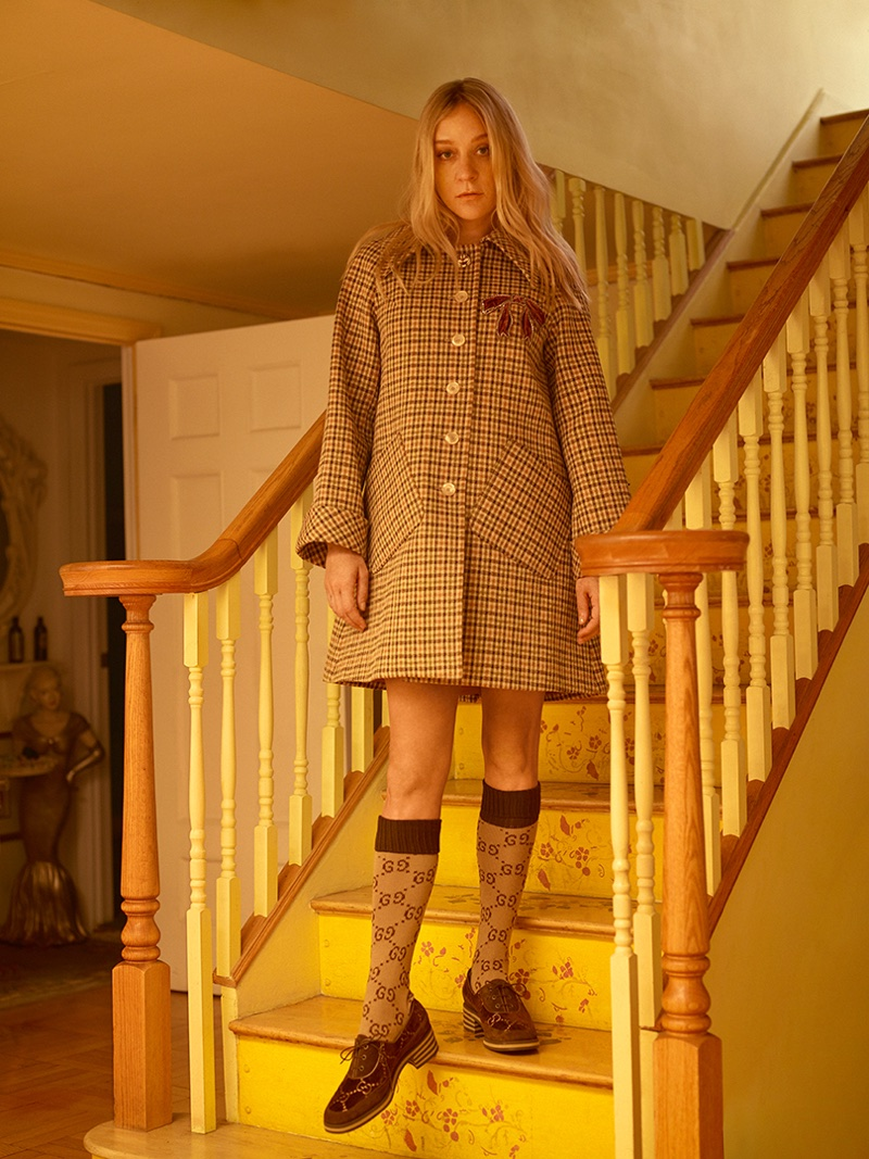 Chloe Sevigny wears checkered coat, socks and loafers from Gucci