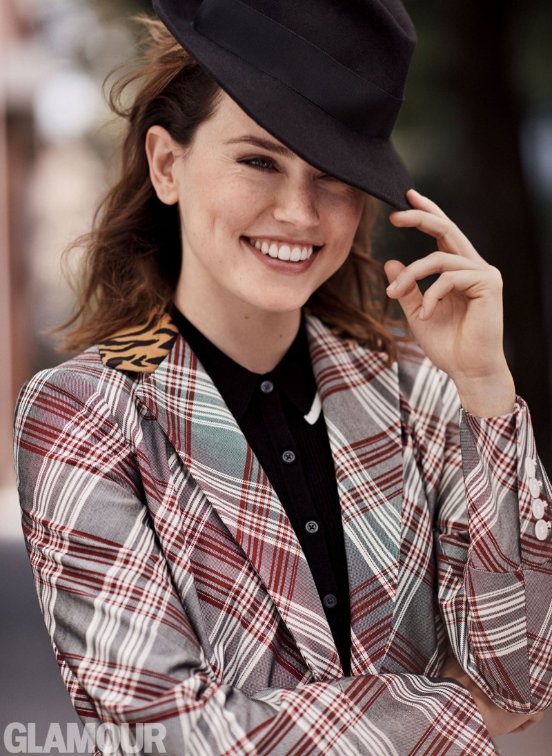 Flashing a smile, Daisy Ridley wears John Galliano coat, Sunday Best for Aritizia dress and East Village Hats fedora