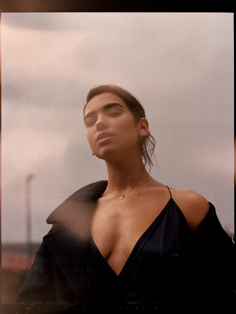 Dua Lipa wears Saint Laurent dress and coat